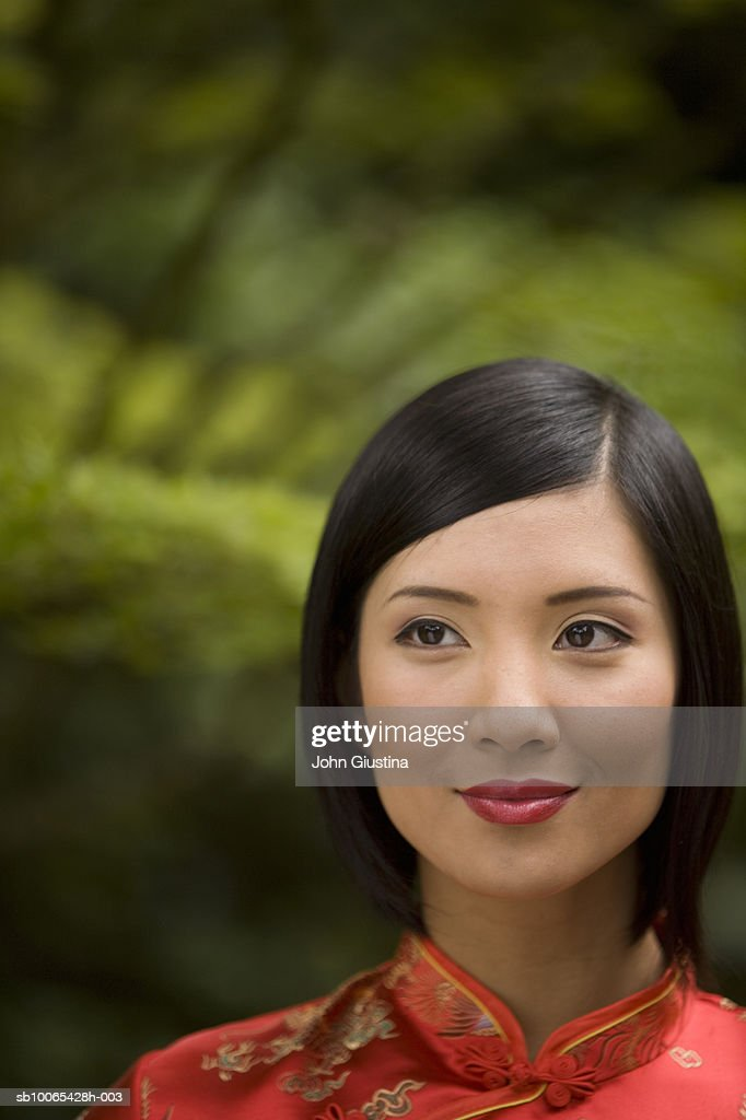 Close-up of young woman wearing red silk dress : Foto stock