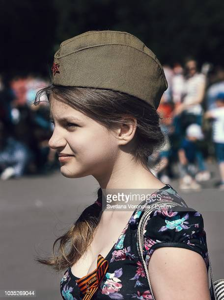 close-up of young woman wearing uniform cap - uniform cap stock pictures, royalty-free photos & images