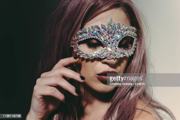 close-up of young woman wearing venetian mask - chelsea mask stock pictures, royalty-free photos & images