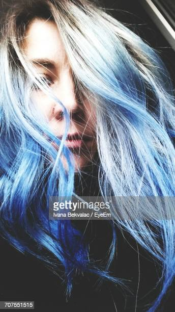 Close-Up Of Young Woman With Blue Dyed Hair