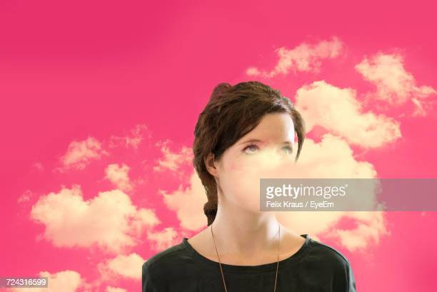 Close-Up Of Young Woman With Clouds