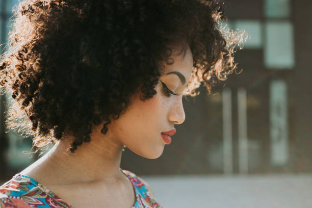 Close-up of young woman with curly hair