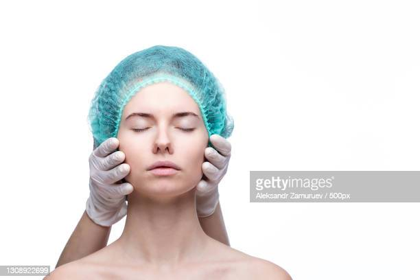 close-up of young woman with eyes closed against white background - correction fluid stock pictures, royalty-free photos & images