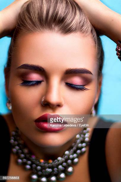 Close-Up Of Young Woman With Eyes Closed In Make-Up
