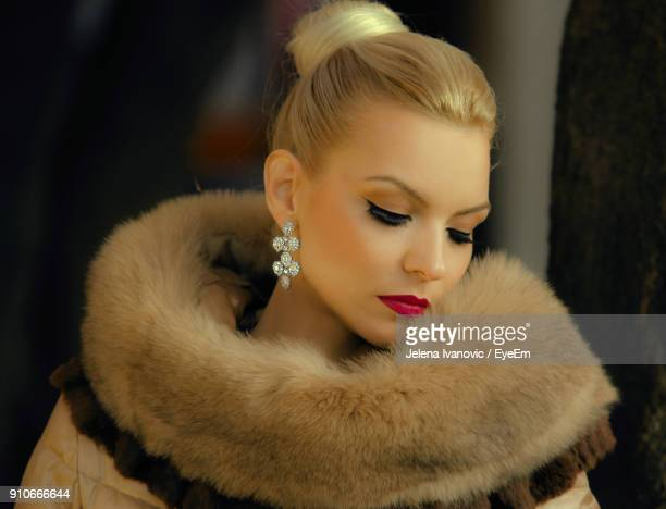 close-up of young woman with eyes closed - fur coat stock pictures, royalty-free photos & images