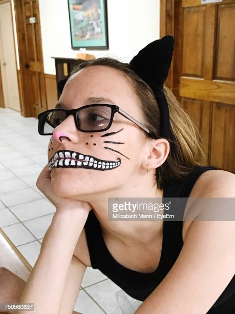 close-up of young woman with face paint - cat costume stock photos and pictures