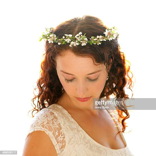 Closeup of young woman with flower crown
