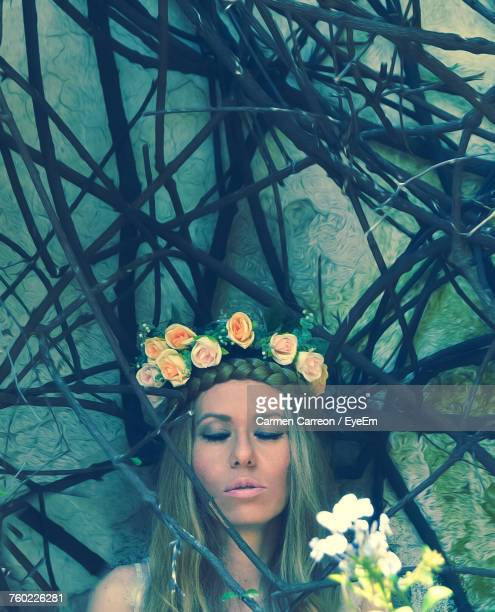 close-up of young woman with flowers - carmen bella foto e immagini stock