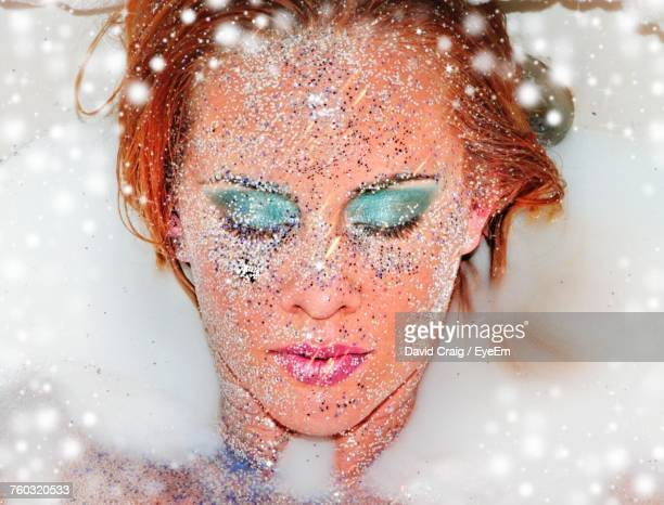 Close-Up Of Young Woman With Glitter On Face Taking Milkbath