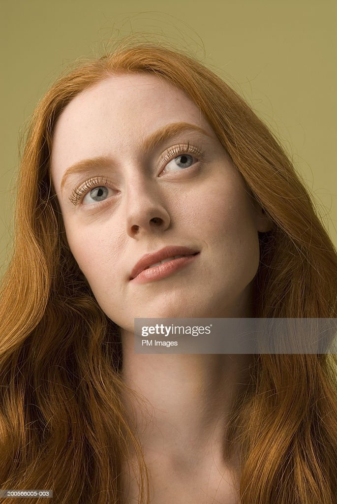 Closeup Of Young Naked Woman With Long Ginger Hair Looking