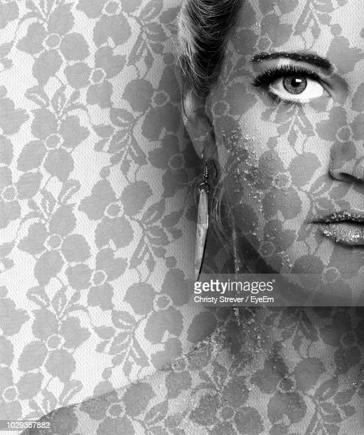 close-up of young woman with make-up against patterned wall - disguise stock pictures, royalty-free photos & images