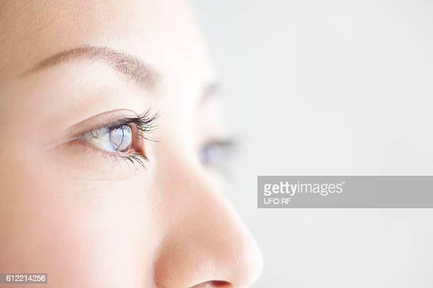 close-up of young woman's eyes - 目 ストックフォトと画像
