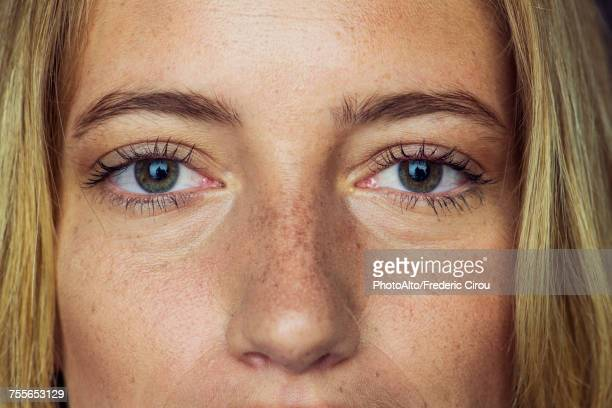 close-up of young womans face and eyes - close up stock pictures, royalty-free photos & images