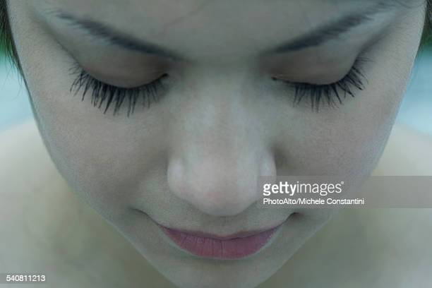 close-up of young womans face, eyes closed - wishful skin stock pictures, royalty-free photos & images