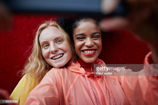 close-up of young women photographing outdoors - generation z stock-fotos und bilder