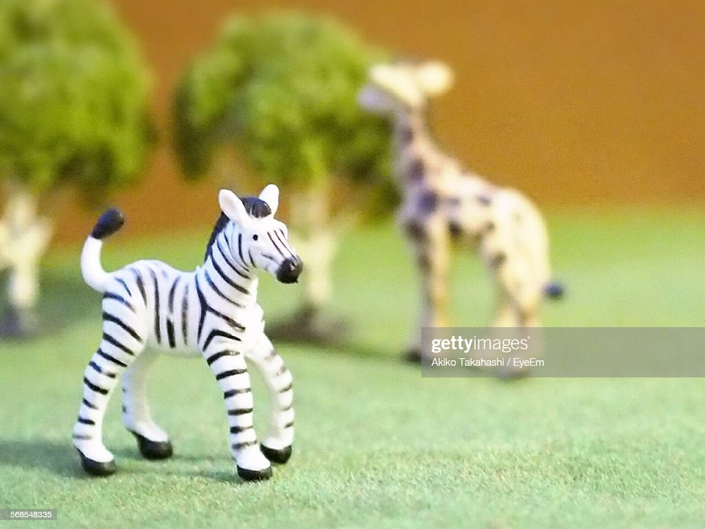 Close-Up Of Zebra And Giraffe Toys : Stock Photo