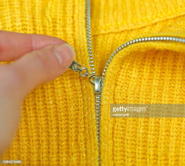 close-up of zipper on yellow sweater - zip stock pictures, royalty-free photos & images
