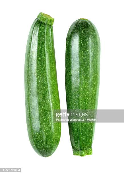 close-up of zucchini against white background - marrow squash stock pictures, royalty-free photos & images