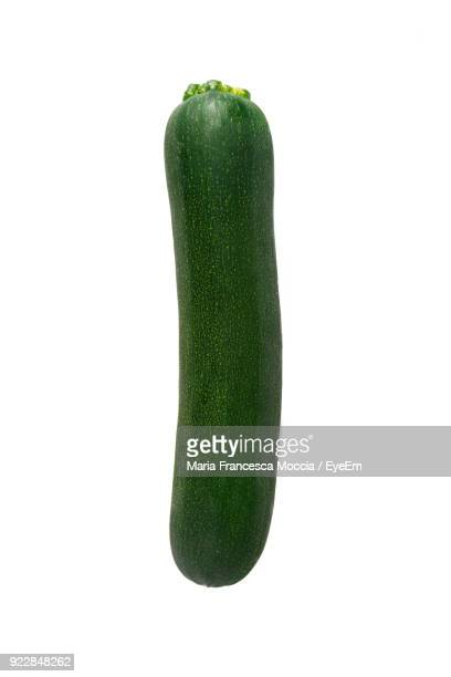 Close-Up Of Zucchini Against White Background