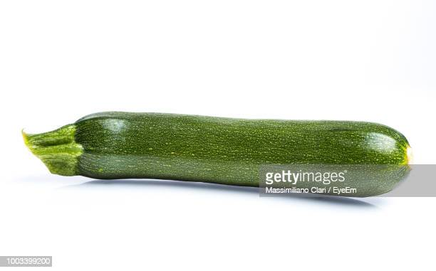 Close-Up Of Zucchini Over White Background
