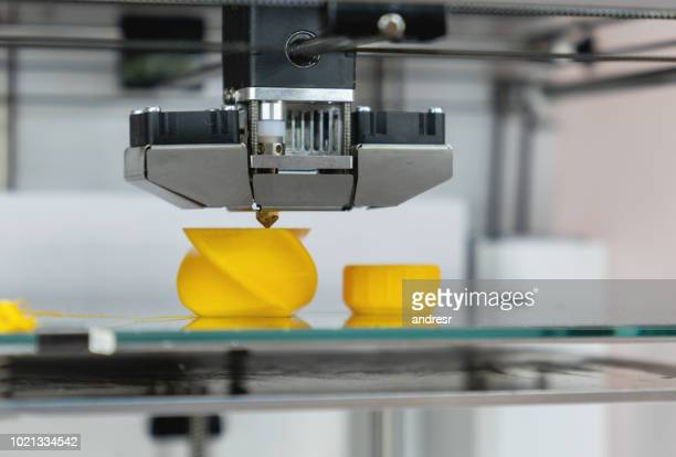 close-up on a 3d printer printing a prototype - 3d printing stock pictures, royalty-free photos & images