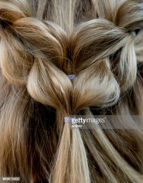 close-up on a beautiful braided hairdo - braided stock pictures, royalty-free photos & images