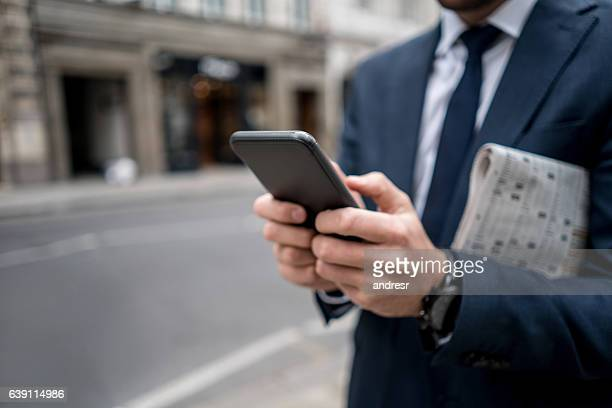 close-up on a business man texting on the phone - publication stock pictures, royalty-free photos & images