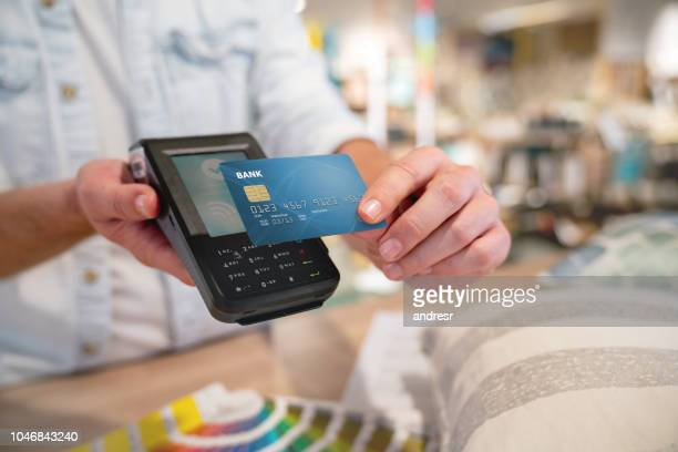 close-up on a contactless payment at a furniture store - input device stock photos and pictures