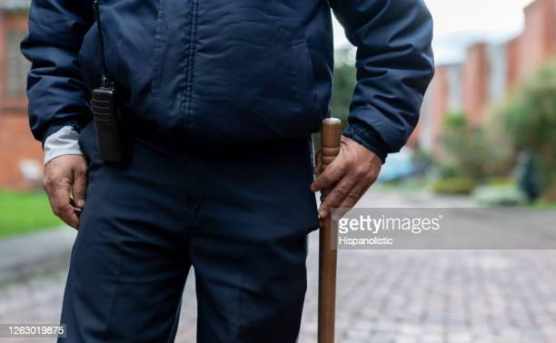 close-up on a security guard holding a nightstick - truncheon stock pictures, royalty-free photos & images
