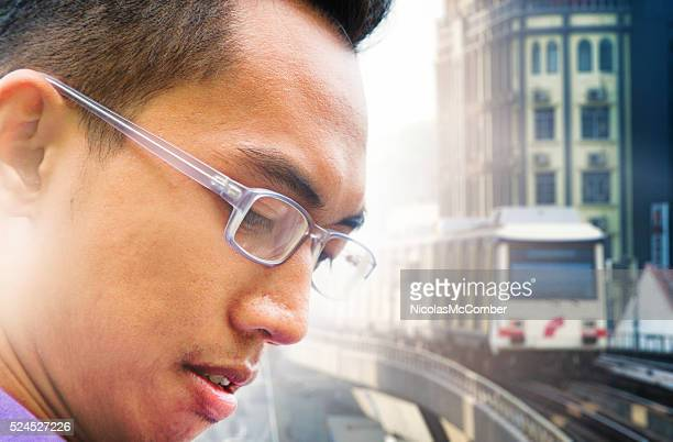 Close-up on Asian male profile waiting for monorail