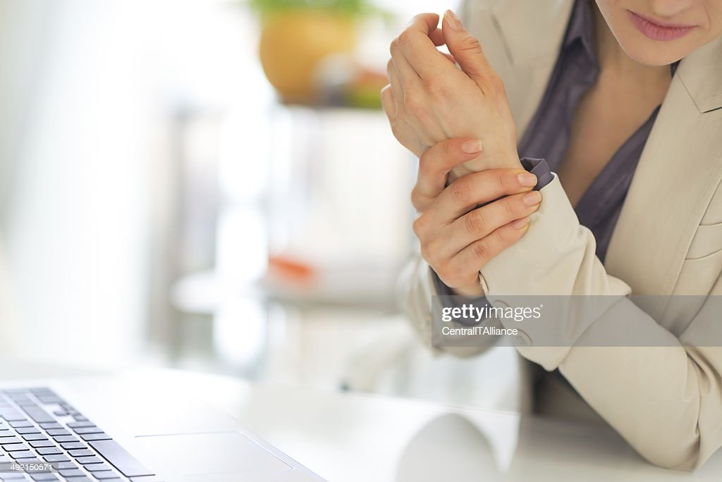 closeup on business woman with wrist pain : Stock Photo