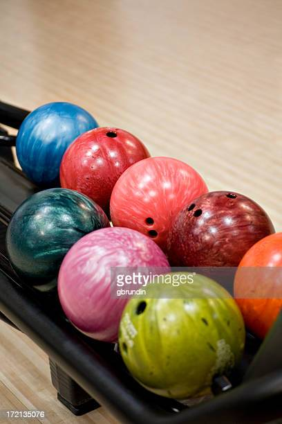 Close-up on colorful bowling balls in the ball return