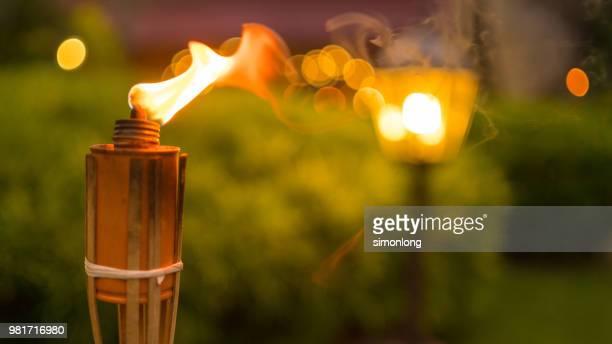Close-up on flame of bamboo torch  prepare for Hari Raya Aidilfitri  celebration