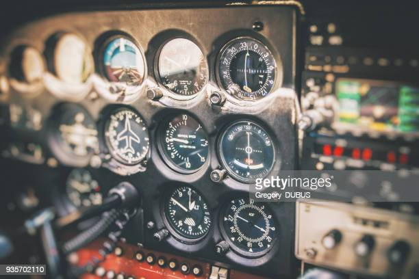 close-up on flight instruments in old small airplane cockpit interior control panel in selective focus - piloting stock pictures, royalty-free photos & images
