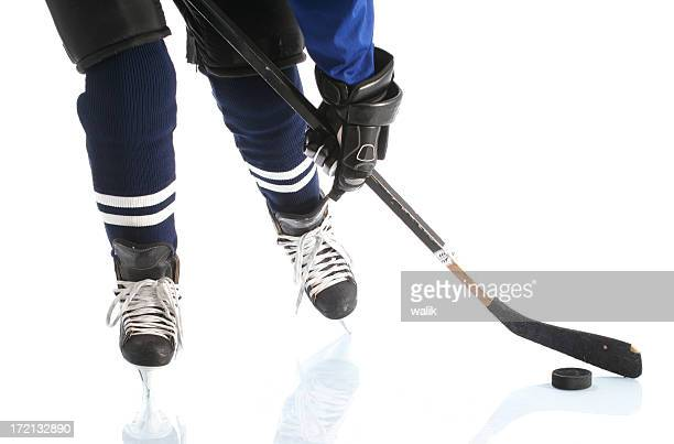 close-up on hockey player  legs - puck stock pictures, royalty-free photos & images
