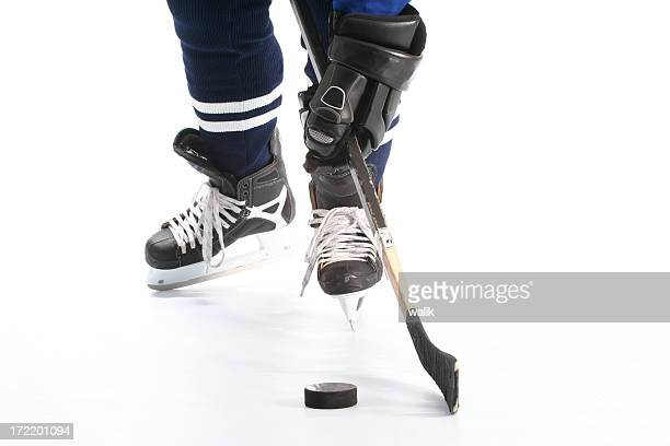 close-up on hockey player  legs - ice hockey glove stock photos and pictures