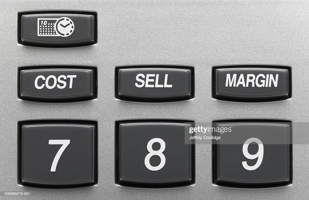 closeup on number sell cost and margin keys on calculator stock