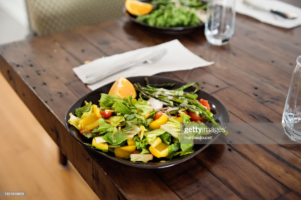 Close-up on plate of colorful salad on a wooden table. : Stock Photo