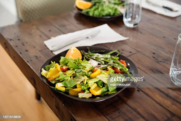 """close-up on plate of colorful salad on a wooden table. - """"martine doucet"""" or martinedoucet stock pictures, royalty-free photos & images"""
