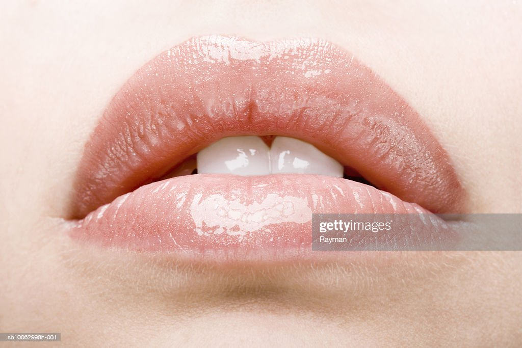 Close-up on slightly open lips with gloss : Stock Photo