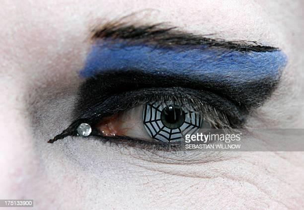 Closeup on the eye with a contact lens with a a spider's net paitning of a participant in an annual WaveGothic festival on May 30 2009 in Leipzig...
