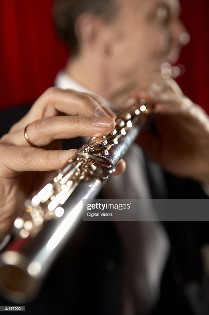 Close-Up on the Hand of a Male Flautist : Stock Photo