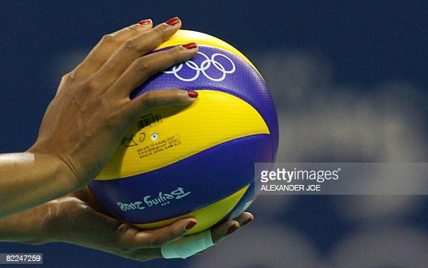 Close-up on the hands of Kimberly Glass of the US holding the ball before serving to members of Cuba's team during their women's preliminary...