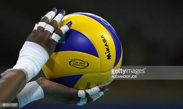Closeup on the hands of Tayyiba HaneefPark of the US holding the ball before serving to members of Cuba's team during their women's preliminary...