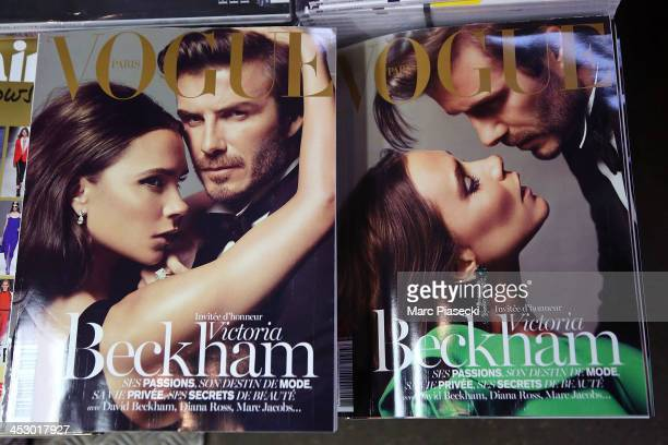 A closeup on the two Vogue magazine 'Victoria and David Beckham' French covers for the latest issue of the magazine which are displayed for sale on...