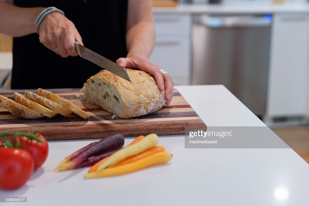 Close-up on woman's hands preparing lunch in home kitchen. : Stock Photo