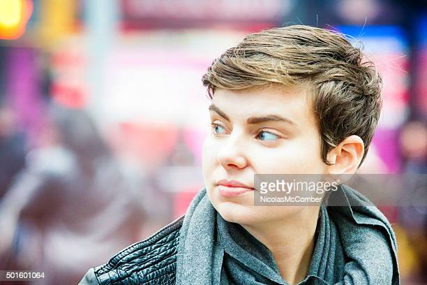 close-up on young woman crossing the street looking left - androgynous stock pictures, royalty-free photos & images