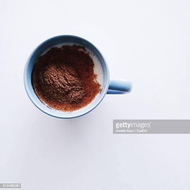 Close-up overhead view of coffee against white background