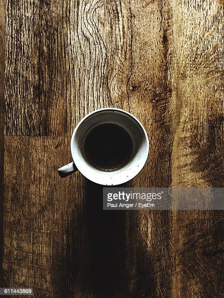 Close-Up Overhead View Of Coffee Cup On Table