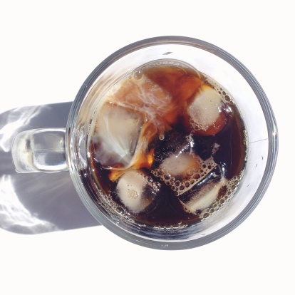 Close-up overhead view of drink with ice cubes over white background - gettyimageskorea